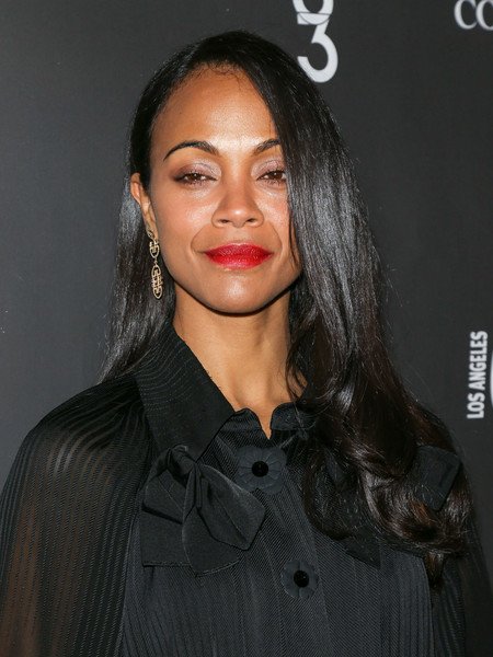 Zoe Saldana wore her locks loose with a side part and curly ends at the Los Angeles Confidential winter issue celebration.