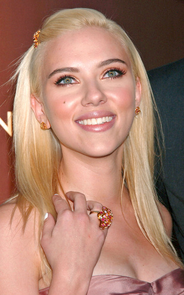 Scarlett was all smiles as she showed off her colorful ring, which coincidentally matched her stud earrings and hair pin.