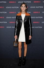 Alexa Chung was edgy and mod at the Louis Vuitton Series 2 exhibition in a black LV leather coat with a contrasting sienna collar.
