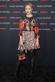 Dianna Agron bravely sported clashing prints with this LV floral mini and flamingo blouse combo.