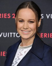 Brie Larson came simply styled with this center-parted ponytail to the Louis Vuitton Series 2 exhibition.
