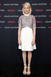 Michelle Williams finished off her cute outfit with white strappy sandals, also by Louis Vuitton.