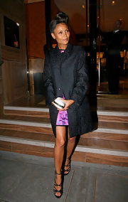 Thandie looks elegant at the Louis Vuitton store opening in a black brocade evening coat.