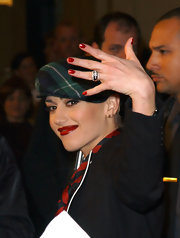 Gwen Stefani flashed an engagement ring and a bright red manicure for the Love Rock Charity Concert.
