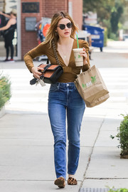 Classic blue jeans finished off Lucy Hale's outfit.