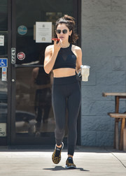 Lucy Hale punctuated her black look with leopard-print running shoes by APL.
