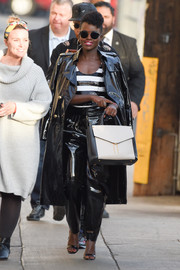 Lupita Nyong'o coordinated her outfit with a two-tone leather tote.