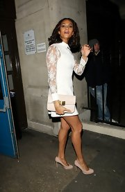 Alesha Dixon complemented her little white dress with a buckled nude clutch when she attended the Music Industry Trusts Awards.
