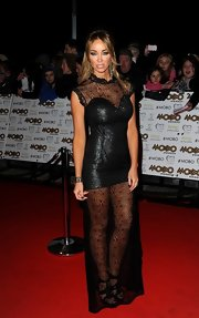 Lauren looked edgy in a black mini dress with a floor-length lace overlay.
