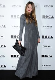 Devon wore an interesting gray striped floor-length gown to MOCA's Annual Gala.
