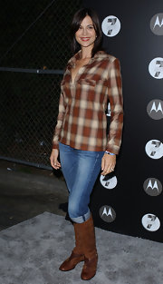 Catherine Bell finished off her look with multi-textured brown boots.
