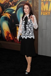 Priscilla Presley attended the 'Mad Max: Fury Road' premiere wearing a sheer, flower-embroidered blouse over an LBD.