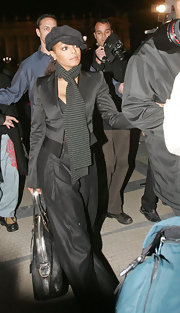 Not afraid to accessorize Janet opts for a black suede cap to spice up her all black outfit