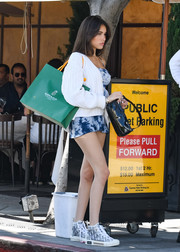 Madison Beer layered a white cable-knit cardigan by Sororite over a tie-dye mini dress for a day of shopping.