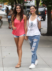 Victoria Justice teamed her tank with majorly distressed jeans by One Teaspoon.