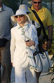 Madonna wore a guazy striped scarf with her all white ensemble.