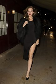 Margo Stilley chose this long black dress with a major front slit for her look while out in Mayfair.