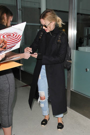 Margot Robbie rocked ripped jeans for a flight to LAX.