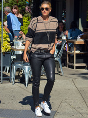 Maria Sharapova opted for comfy white sneakers to complete her look.