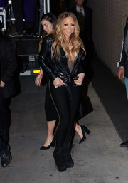 Mariah Carey pulled her look together with black platform lace-up boots.