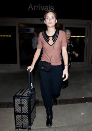 Marion showed off her quirky yet chic style in this clever blouse at LAX.