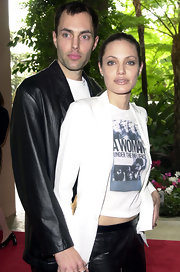 Angelina posed with her brother in a white blazer and graphic tee with leather pants.