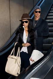 Camila Alves looked stylish at the airport carrying an ivory Muxo by Camila Alves Soft Pebble Leather Tote.