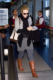 Rachel McAdams strolled through LAX in the boot of the season, flat cognac knee highs.