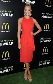 Peta Murgatroyd looked classic and elegant in a blood red dress with a descending peplum ruffled waist.