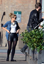 Vogue Williams channeled British cool in a pair of leather hot pants with gold zipper details as she stepped out for a bite with new beau Brian McFadden.