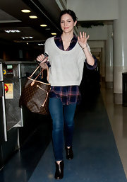 Katharine McPhee opted for chic travel style, wearing leather ankle boots.