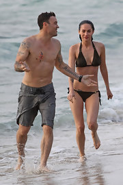 Brian Austin Green has a phoenix rising from the ashes tattoo on his left shoulder.