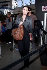 Megan Fox was stylish on the go toting a supple tan leather messenger bag.
