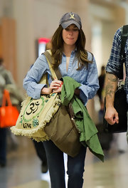 Megan Fox carried a '60s style fringed tote complete with peace symbols.