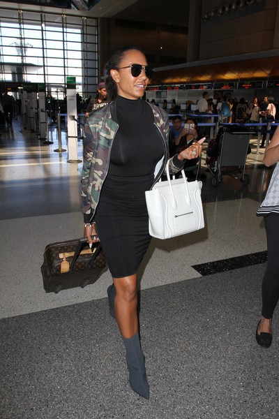 Melanie Brown was tough-glam in a camo-print bomber jacket while making her way through LAX.