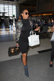 Melanie Brown sealed off her head-turning airport outfit with gray mid-calf boots.