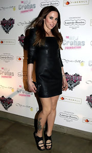 Mel C went for a tough chick look with this black leather dress at the Rock Ball.