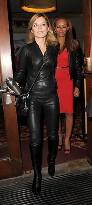 Geri Halliwell spiced up her look with leather pants that complemented her monochromatic look.