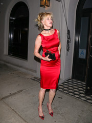 Melanie Griffith sealed off her ensemble with a black box clutch.