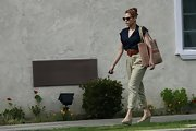 Eva Mendes looked opted for a retro-inspired blouse and high-waisted pants for a cool and casual look.