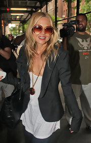 "Rachel sported a retro pair of angled, oversized ""Hexagonal Sunglasses"" with gold and tortoise shell detailing."