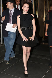 Emma paired her cinched dress with a matching buckled clutch that was the perfect complement to her look.