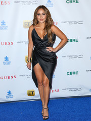 Adrienne Bailon looked hot in a cleavage-and-thigh-baring wrap dress during the La Vie En Bleu event.