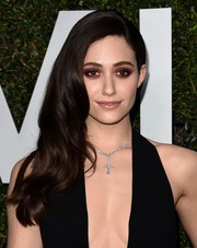 Emmy Rossum complemented her decollete dress with a diamond cross pendant necklace.