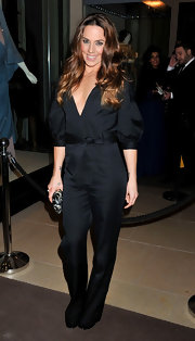 Puffed sleeves and a bowed belt added a feminine touch to Mel C's black jumpsuit at the Symphonica concert.