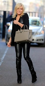 Michelle Collins looked ready to take on the city in a slick pair of leather pants.