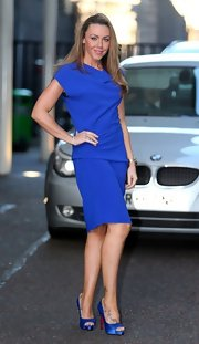 Michelle Heaton looked chic wearing a blue knee-length dress with a cowl neckline when spotted outside the London Studios.