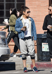 Mila Kunis topped off her casual outfit with a denim jacket by Levi's.