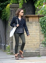 Mila wore a navy pea coat with leather trim while out in London.