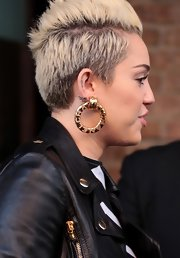 Miley Cyrus channeled the '80s with oversized gold hoop earrings while visiting NYC.